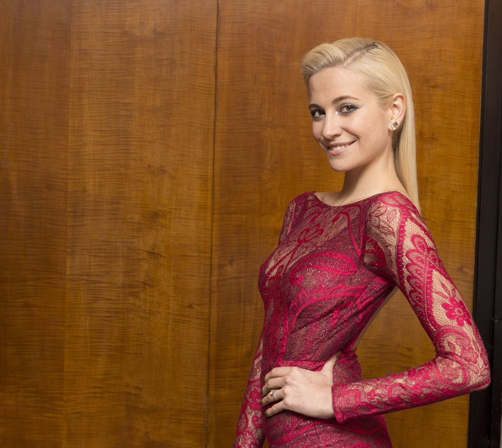Pixie Lott preparing to host the Prince's Trust Invest In Futures evening at the Savoy Hotel, The Strand. Qs: What's wrong with this composition? Why is there a big empty space to the left of her head? A: The client needs some clear space to put their copy text over the picture.